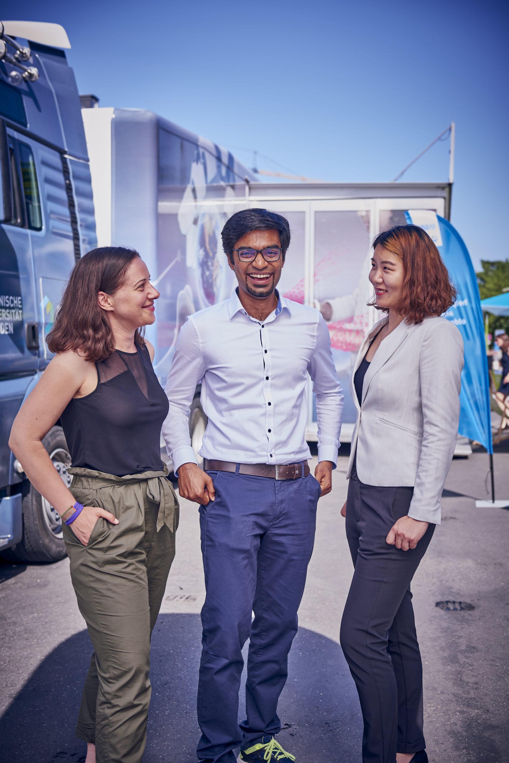 3 CeTI team members in front of the CeTI truck